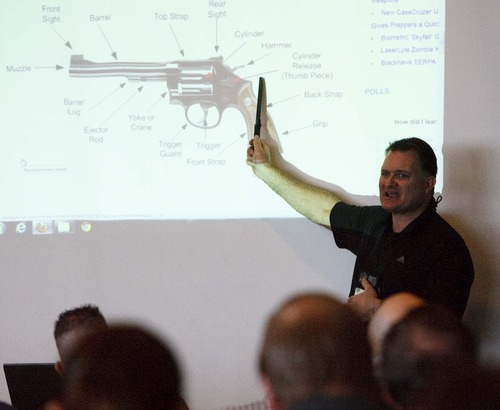 Leah Hogsten  |  The Salt Lake Tribune Concealed firearms instructor Clark Aposhian teaches the Utah Shooting Sports Council's free Concealed Carry Weapons Class and Mass Violence Response Training at the Maverik Center Thursday December 27, 2012 in West Valley City. Utah teachers with a concealed carry permit can already carry firearms into classrooms. The course is open to all school employees ranging from teachers, bus drivers, principals and custodians.