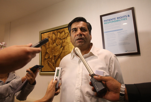 Indian High Commissioner to Singapore, T.C.A. Raghavan speaks to reporters about the death of a young Indian woman who was gang raped, at Mount Elizabeth Hospital late on Saturday Dec. 29, 2012 in Singapore. The woman who was gang-raped and severely beaten on a bus in New Delhi died Saturday at the hospital, after her horrific ordeal galvanized Indians to demand greater protection from sexual violence that impacts thousands of women daily, in homes, streets and public transport, but which often goes unreported. (AP Photo/Wong Maye-E)