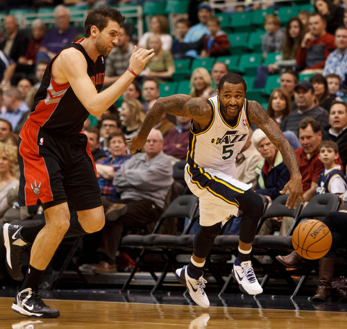 Trent Nelson  |  The Salt Lake Tribune Utah Jazz point guard Mo Williams (5) brings the ball upcourt as the Utah Jazz face the Toronto Raptors Friday December 7, 2012.