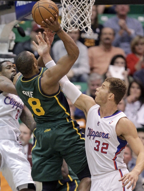 Los Angeles Clippers power forward Blake Griffin (32) fouls Utah Jazz point guard Randy Foye (8) in the first quarter during an NBA basketball game on Friday, Dec. 28, 2012, in Salt Lake City. (AP Photo/Rick Bowmer)