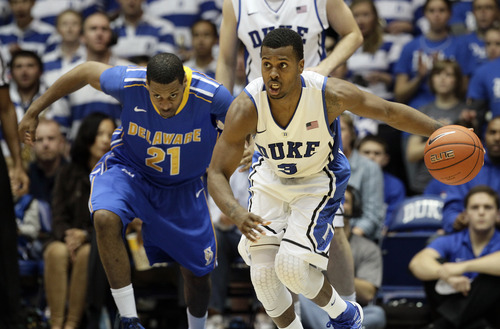 Duke's Tyler Thornton (3) dribbles as Delaware's Marvin King-Davis (21) chases during the second half of an NCAA college basketball game in Durham, N.C., Saturday, Dec. 1, 2012. Duke won 88-50. (AP Photo/Gerry Broome)