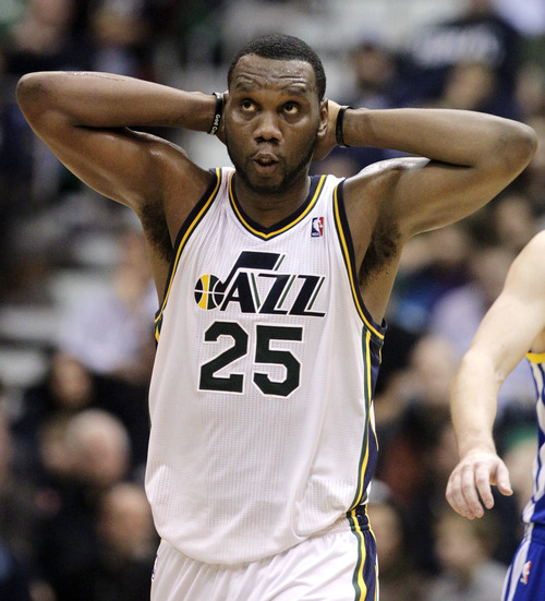 Utah Jazz center Al Jefferson (25) reacts after a teammate's turnover in the second quarter of an NBA basketball game against the Golden State Warriors, Wednesday, Dec. 26, 2012, in Salt Lake City. (AP Photo/Rick Bowmer)