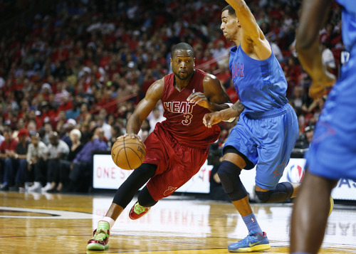 Miami Heat's Dwyane Wade during the first half a NBA basketball game in Miami, Tuesday, Dec. 25, 2012 against the Oklahoma City Thunder. (AP Photo/J Pat Carter)