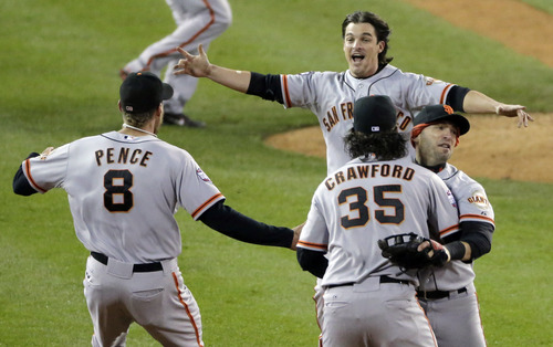 San Francisco Giants right fielder Hunter Pence (8), second baseman Ryan Theriot, shortstop Brandon Crawford (35) and second baseman Marco Scutaro celebrate after the Giants defeated the Detroit Tigers, 4-3, in Game 4 of baseball's World Series  Sunday, Oct. 28, 2012, in Detroit. The Giants won the World  Series 4-0. (AP Photo/Charlie Riedel)