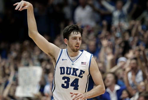 Duke's Ryan Kelly (34) reacts following his basket against Ohio State during the second half of an NCAA college basketball game in Durham, N.C., Wednesday, Nov. 28, 2012. Duke won 73-68. (AP Photo/Gerry Broome)