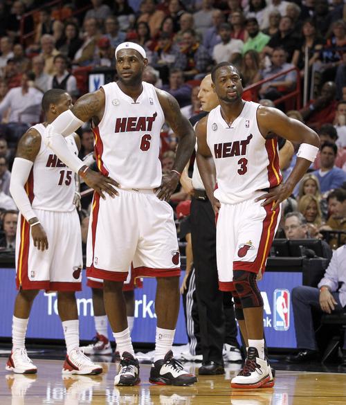 Miami Heat's LeBron James (6) and Miami Heat's Dwyane Wade (3) are shown during an NBA basketball game against the San Antonio Spurs Thursday, Nov. 29, 2012,  in Miami. ( AP Photo/Alan Diaz)