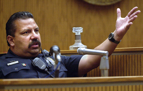 FILE - In this May 10, 2001, file photo, El Cajon, Calif., Police department school resource officer Rich Agundez Jr., who confronted and wounded a student who attacked Granite Hills High School with a shotgun in 2001, testifies in El Cajon. The National Rifle Association's response to a Connecticut school massacre envisions, in part, having trained, armed volunteers in every school in America. But Agundez, school safety experts and school board members say there's a huge difference between a trained law enforcement officer who becomes part of the school family _ and a guard with a gun.  (AP Photo/U-T San Diego, John Gastaldo)  SAN DIEGO COUNTY OUT; NO SALES; COMMERCIAL INTERNET OUT; FOREIGN OUT