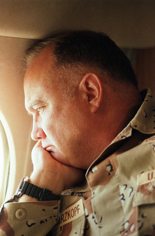 FILE - In this Jan. 13, 1991 file photo, General H. Norman Schwarzkopf, commander of U.S. troops in the Gulf, gazes from the window of his small jet on his way out to visit U.S. troops in the desert in Saudi Arabia.  Schwarzkopf died Thursday, Dec. 27, 2012 in Tampa, Fla. He was 78. (AP Photo/Bob Daugherty, File)
