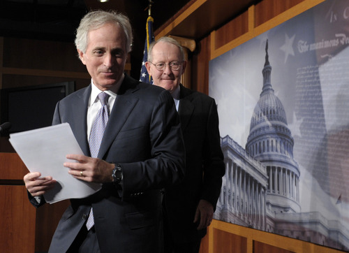 Sen. Bob Corker, R-Tenn., left, and Sen. Lamar Alexander, R-Tenn., turn to leave a news conference where they discussed the fiscal cliff, Friday, Dec. 28, 2012, on Capitol Hill in Washington. (AP Photo/Susan Walsh)