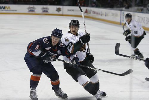 Scott Sommerdorf   |  The Salt Lake Tribune The Grizzlies Trevor Lewis rushes into the zone on offense against Matthew Clune of the Reign during second period play. The Grizzlies led the Ontario Reign 3-2 at the end of two periods, as Trevor Lewis makes his debut with the team, Friday, December 28, 2012. Lewis scored a goal and assisted on another through two periods.