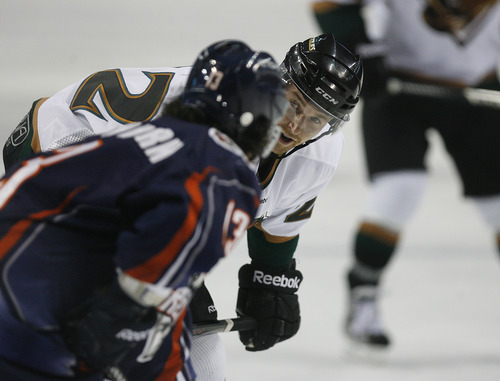 Scott Sommerdorf   |  The Salt Lake Tribune The Grizzlies Trevor Lewis talks with Ontario's Colton Yellow Horn prior to a face off during the second period. The Grizzlies led the Ontario Reign 3-2 at the end of two periods, as Trevor Lewis makes his debut with the team, Friday, December 28, 2012. Lewis scored a goal and assisted on another through two periods.