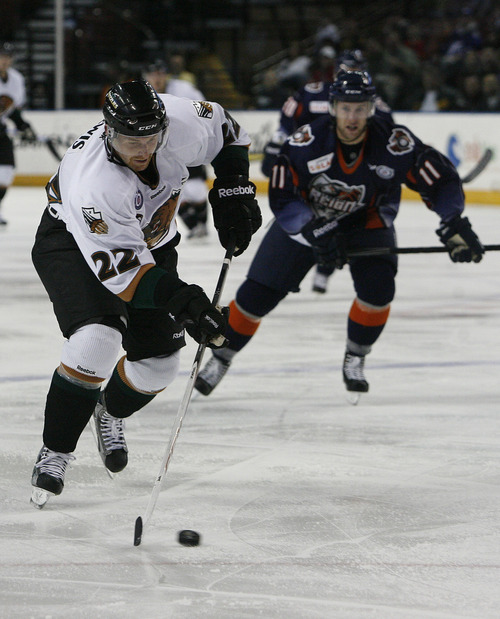 Scott Sommerdorf   |  The Salt Lake Tribune Trevor Lewis controls the puck and is being chased by Ontario winger Everett Sheen during second period play. The Grizzlies led the Ontario Reign 3-2 at the end of two periods, as Trevor Lewis makes his debut with the team, Friday, December 28, 2012. Lewis scored a goal and assisted on another through two periods.