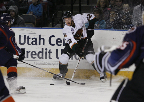 Scott Sommerdorf   |  The Salt Lake Tribune Trevor Lewis battles for control of the puck along the boards during second half play. He had a goal and an assist through two periods. The Grizzlies led the Ontario Reign 3-2 at the end of two periods, as Trevor Lewis makes his debut with the team, Friday, December 28, 2012. Lewis scored a goal and assisted on another through two periods.