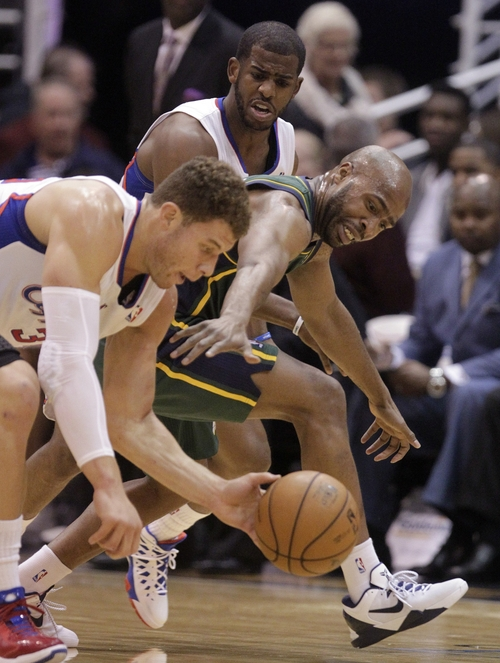 Los Angeles Clippers power forward Blake Griffin, left, steals the ball from Utah Jazz point guard Jamaal Tinsley, right, while Clippers point guard Chris Paul, rear, looks on in the first quarter during an NBA basketball game on Friday, Dec. 28, 2012, in Salt Lake City. (AP Photo/Rick Bowmer)