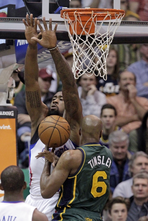 Utah Jazz point guard Jamaal Tinsley (6) loses the ball as Los Angeles Clippers center DeAndre Jordan, left,  defends in the first quarter during an NBA basketball game on Friday, Dec. 28, 2012, in Salt Lake City. (AP Photo/Rick Bowmer)