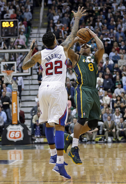 Los Angeles Clippers forward Matt Barnes (22) defends as Utah Jazz guard Randy Foye (8) makes a 3-point shot as time expires during an NBA basketball game Friday, Dec. 28, 2012, in Salt Lake City. The Clippers defeated the Jazz 116-114. (AP Photo/Rick Bowmer)