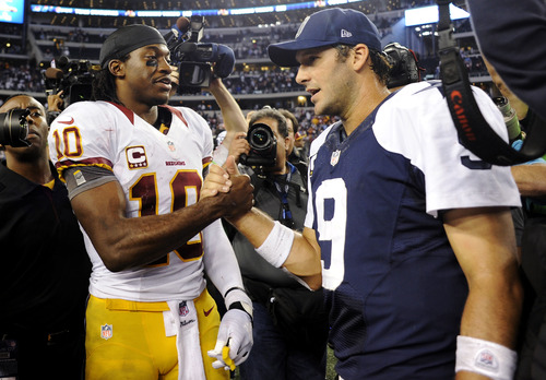 ADVANCE FOR WEEKEND EDITIONS, DEC. 29-30 - FILE - In this Nov. 22, 2012, file photo, Washington Redskins quarterback Robert Griffin III (10) and Dallas Cowboys quarterback Tony Romo (9) greet after the Redskins won 38-31 in an NFL football game in Arlington, Texas. The Cowboys and  Redskins have played 103 times, but rarely have the stakes been this high. On Sunday, the winner gets the NFC East. The loser stays home for the playoffs, or maybe gets a wild card berth if things go just right.  (AP Photo/Matt Strasen, File)