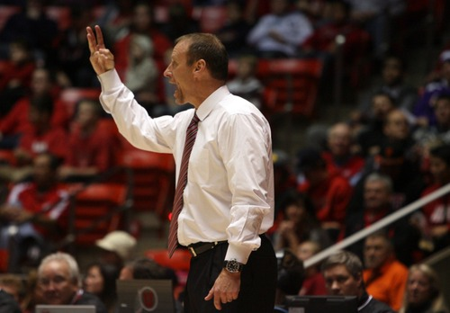 Kim Raff  |  The Salt Lake Tribune University of Utah head coach Larry Krystkowiak calls a play on the sidelines during a game against College of Idaho at the Huntsman Center in Salt Lake City on December 28, 2012.
