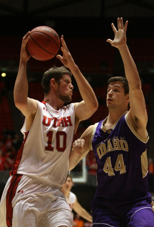 Kim Raff  |  The Salt Lake Tribune (left) University of Utah forward Renan Lenz (10) drives the basket past College of Idaho player Bryden Benke during a game at the Huntsman Center in Salt Lake City on December 28, 2012.