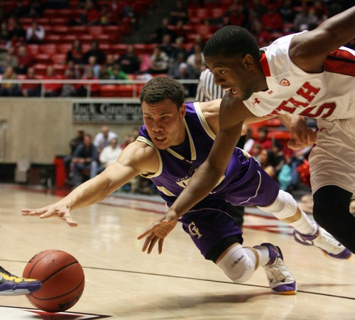 Kim Raff  |  The Salt Lake Tribune University of Utah guard (right) Jarred DuBois (5) and College of Idaho player Sydney Donaldson scramble for a loose ball at the Huntsman Center in Salt Lake City on December 28, 2012.