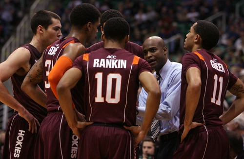 Leah Hogsten  |  The Salt Lake Tribune Virginia Tech Hokies head coach James Johnson gathers his team after he received a technical foul in the first half.  Brigham Young University defeated Virginia Tech 97-71, Saturday December 29, 2012 in Salt Lake City at Energy Solutions Arena.