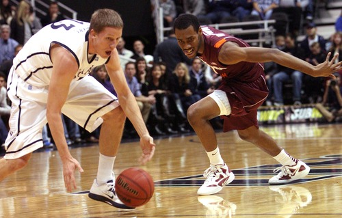 Leah Hogsten  |  The Salt Lake Tribune Brigham Young Cougars guard Brock Zylstra (13) steals the ball from Virginia Tech Hokies guard Robert Brown (1) during the first half.  Brigham Young University defeated Virginia Tech 97-71, Saturday December 29, 2012 in Salt Lake City at Energy Solutions Arena.