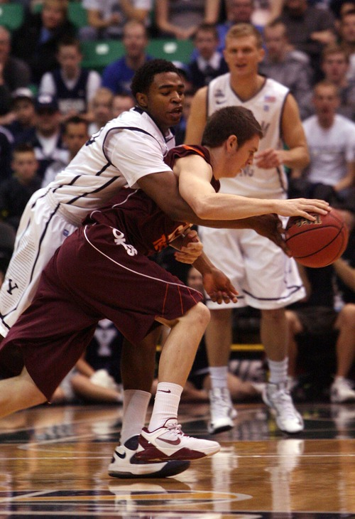 Leah Hogsten  |  The Salt Lake Tribune Brigham Young Cougars guard Anson Winder (20) tries to steal the ball from Virginia Tech Hokies guard Will Johnston (25).  Brigham Young University leads Virginia Tech at the half Saturday December 29, 2012 in Salt Lake City at Energy Solutions Arena.