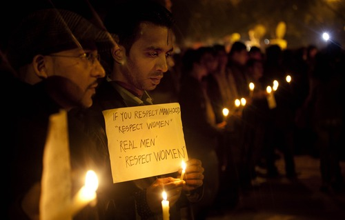 Indians participate in a candle-lit vigil to mourn the death of a gang rape victim in New Delhi, India, Sunday, Dec. 30, 2012. The woman who died after being gang-raped and beaten on a bus in India's capital was cremated Sunday amid an outpouring of anger and grief by millions across the country demanding greater protection for women from sexual violence. (AP Photo/ Dar Yasin)