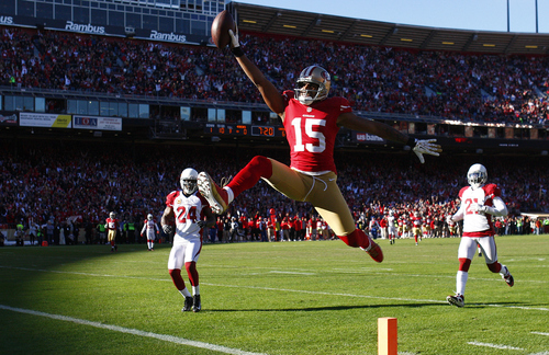 San Francisco 49ers wide receiver Michael Crabtree (15) scores on a 49-yard touchdown reception against the Arizona Cardinals during the second quarter of an NFL football game in San Francisco, Sunday, Dec. 30, 2012. (AP Photo/San Francisco Chronicle, Carlos Avila Gonzalez)  MANDATORY CREDIT; MAGAZINES OUT; TV OUT