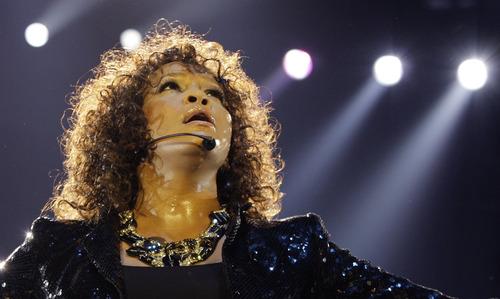 FILE - In this Sunday, April 25, 2010, file photo, U.S singer Whitney Houston performs in London as part of her European tour. Houston, 48, died Feb. 11, 2012.   (AP Photo/Joel Ryan, File)