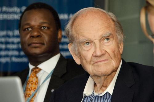 FILE - In this May 17, 2012 file photo, US Senator George McGovern with WFP Country Director Stanlake Samkange in Kampala, Uganda.   McGovern, 90, former U.S. senator and a Democrat who lost to President Richard Nixon in 1972 in a landslide died Oct. 21, 2012.  (AP Photo/Marc Hofer)