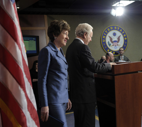 Senate Homeland Security Committee Chairman Sen. Joseph Lieberman, I-Conn. listens at right, and the committee's ranking Republican, Sen. Susan Collins, R-Maine, arrive for a news conference on Capitol Hill in Washington, Monday, Dec. 31, 2012, to discuss the committee's report on the security deficiencies at the temporary U.S. Mission in Benghazi, Libya. (AP Photo/Susan Walsh)