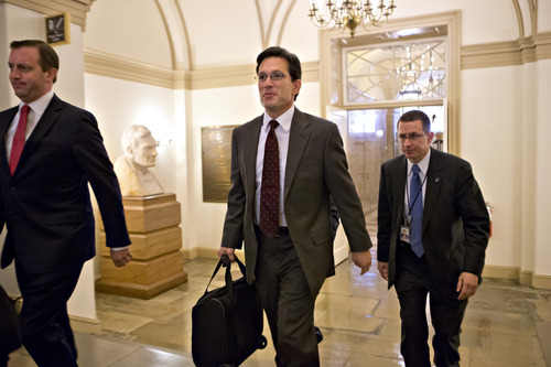 House Majority Leader Eric Cantor of Va. arrives on Capitol Hill in Washington, Monday, Dec. 31, 2012, as leaders in the Senate and the House face pressure to find a legislative path to head off the automatic tax hikes and spending cuts set to take effect Jan. 1.   (AP Photo/J. Scott Applewhite)