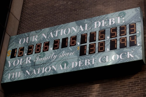 A sign showing the U.S. national debt is displayed in New York, Monday, Dec. 31, 2012. Working against a midnight deadline, negotiators for the White House and congressional Republicans narrowed their differences Monday on legislation to avert across-the-board tax increases. (AP Photo/Seth Wenig)