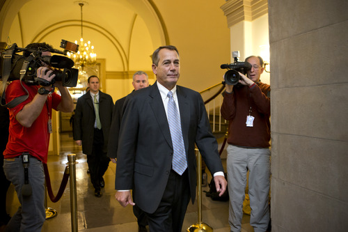 Speaker of the House John Boehner, R-Ohio, arrives at the Capitol as leaders in the Senate and the House face pressure to find a legislative path to head off the automatic tax hikes and spending cuts set to take effect Jan. 1, in Washington, Monday, Dec. 31, 2012.   (AP Photo/J. Scott Applewhite)