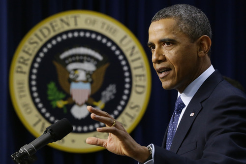 """President Barack Obama gestures as he speaks about the fiscal cliff, Monday, Dec. 31, 2012, in the South Court Auditorium at the White House in Washington. The president said it appears that an agreement to avoid the fiscal cliff is """"in sight,"""" but says it's not yet complete and work continues.  (AP Photo/Charles Dharapak)"""
