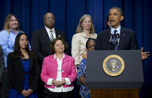 "President Barack Obama gestures as he speaks about the fiscal cliff, Monday, Dec. 31, 2012, in the South Court Auditorium at the White House in Washington. The president said it appears that an agreement to avoid the fiscal cliff is ""in sight,"" but says it's not yet complete and work continues. (AP Photo/Carolyn Kaster)"