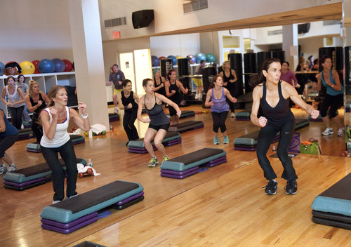 """(AP Photo/Rachel Neville) If you decide to take classes at gyms, such as this one to help skiers get in shape, or just want a place to work out, """"go at least three times a week to get your dollar's worth and to benefit,"""" said Denise Austin, fitness expert and author of """"Side Effect: Skinny."""""""