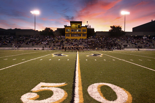 Tribune file photo Scott Cate spent millions of dollars on Cottonwood High's football program, paying for a press box and a new field.