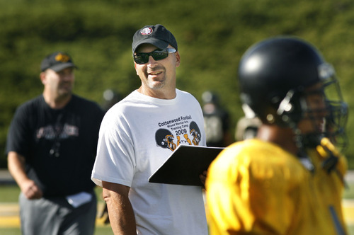 "Tribune file photo What did Scott Cate, shown here in a 2010 football practice, get out of donating millions of dollars? ""Every day, I had 100 kids who I could impact by teaching them lessons through … football. The football field was my church."""