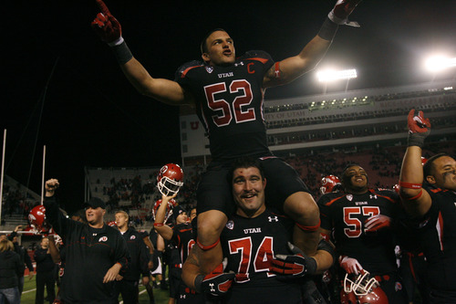 "Tribune file photo Former Colts linebacker Matt Martinez, who went on to play at the U., pictured here (52) celebrating a Utah win in 2011, said, ""Even now, Scott [Cate]'s kind of the voice in my head, telling me to grind. … He did that with everybody he coached. He never showed up unprepared."""