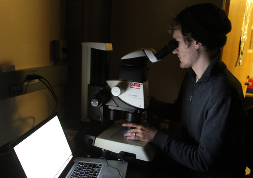 Rick Egan  | The Salt Lake Tribune  Graduate student Michael Jensen works on a project in a lab at the University of Utah.