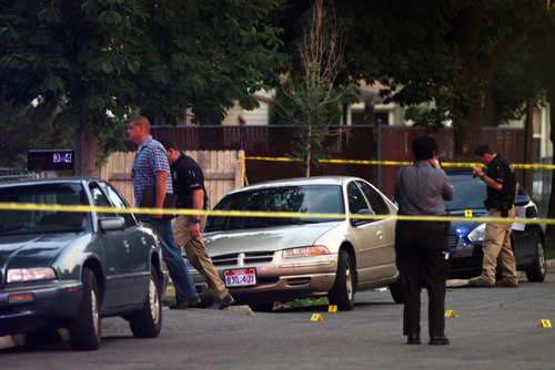 Kim Raff | Tribune file photo Police investigate a fatal shooting on Grant Street in Salt Lake City  on Saturday, July 28, 2012. Guns kill more people in Utah than do car crashes. Most of those deaths are suicides.