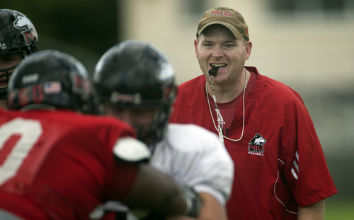Northern Illinois coach Rod Carey works with his players during NCAA college football practice, Wednesday, Dec. 26, 2012, in Miami, for the Orange Bowl. Northern Illinois faces Florida State on New Year's Day. (AP Photo/J Pat Carter)