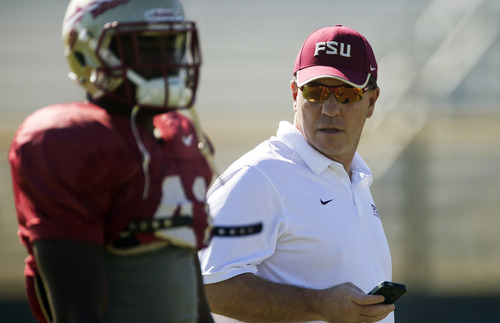 Florida State head coach Jimbo Fisher, right, appears during practice, Thursday, Dec. 27, 2012, in Davie, Fla. Florida State is scheduled to play Northern Illinois in the Orange Bowl NCAA college football game on Tuesday, Jan. 1, 2013. (AP Photo/J Pat Carter)
