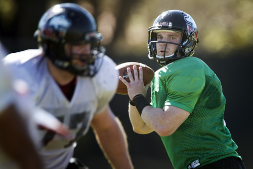 Northern Illinois quarterback Jordan Lynch looks to pass during practice, Thursday, Dec. 27, 2012, in Miami. Northern Illinois is scheduled to play Florida State in the Orange Bowl NCAA college football game on Tuesday, Jan. 1, 2013. (AP Photo/J Pat Carter)