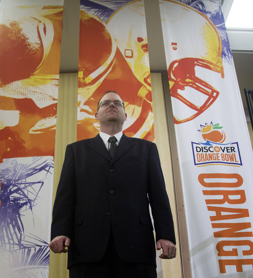 Northern Illinois coach Rod Carey poses for photos after the coaches' news conference for the Orange Bowl NCAA college football game in Fort Lauderdale, Fla., Monday, Dec. 31, 2012. Northern Illinois is scheduled to play Florida State in the New Year's Day game. (AP Photo/J Pat Carter)