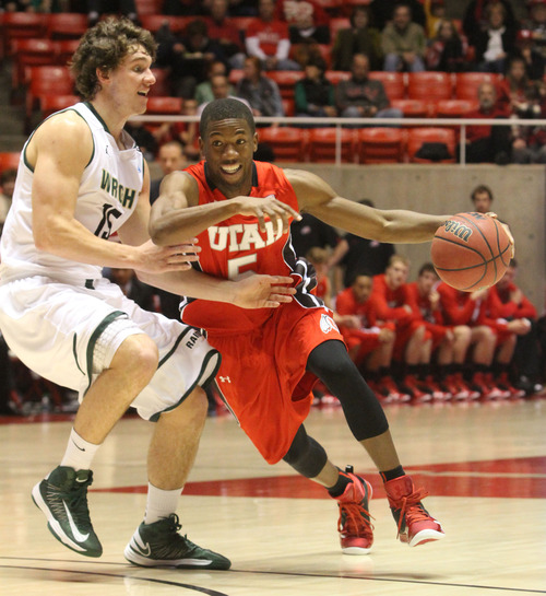 Rick Egan  | The Salt Lake Tribune   Utah Utes guard Jarred DuBois (5) takes the ball inside, as Wright State Raiders guard Kendall Griffin (15) defends, in the Thanksgiving Tournament at the Huntsman Center, Saturday, November 24, 2012.