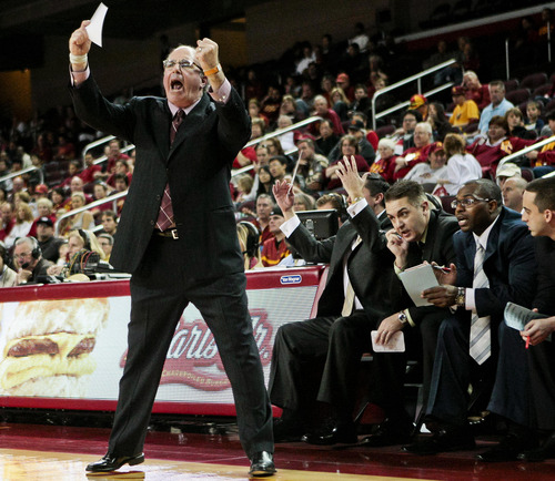 Southern California head coach Kevin O'Neill yells from the bench during the first half of an NCAA college basketball game against New Mexico, Saturday, Dec. 10, 2011, in Los Angeles. New Mexico won 44-41. (AP Photo/Bret Hartman)