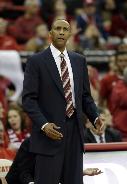 Stanford Cardinal head coach Johnny Dawkins reacts during the first half of an NCAA college basketball game against North Carolina State in Raleigh, N.C., Tuesday, Dec. 18, 2012. (AP Photo/Gerry Broome)